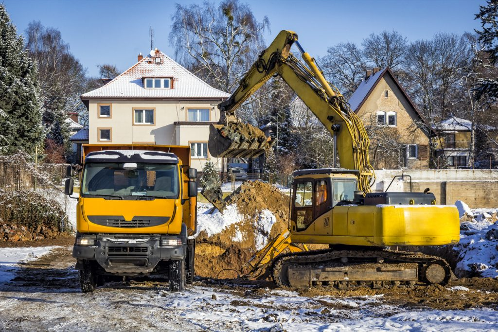 Dump truck and Excavator working in a new building construction project